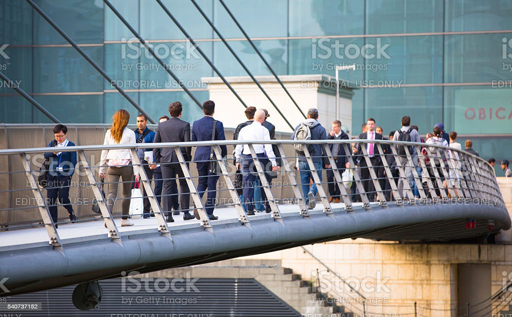 Business people crossing the bridge, Canary Wharf, London stock photo