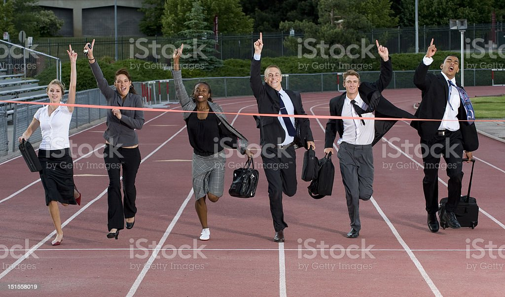 Business People Crossing the Finish Line stock photo