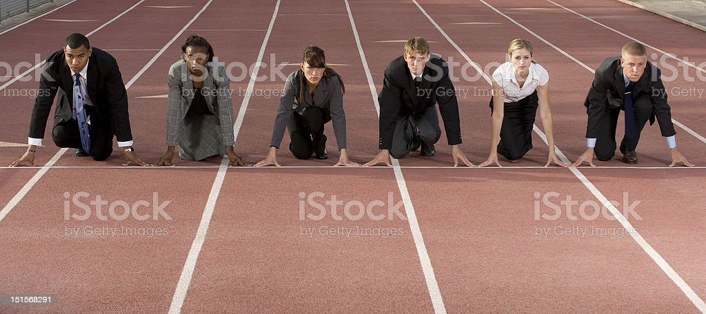 Business People Crouching at Starting Line stock photo