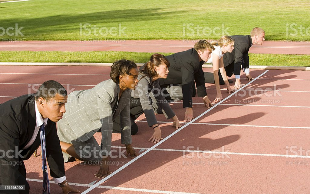 Business People Crouching at Track Starting Line stock photo