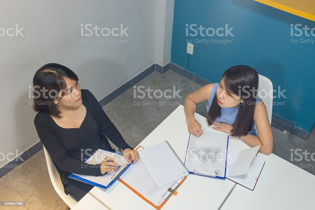 Business people discuss to each other about reports stock photo