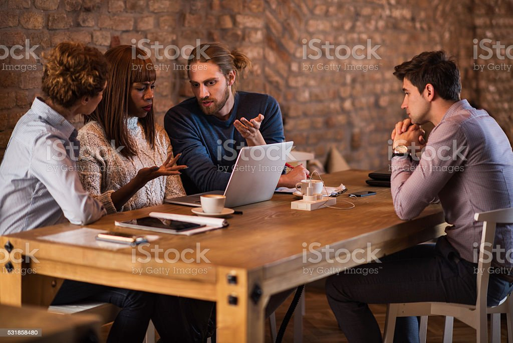 Business people discussing about potential colleague at job interview. stock photo