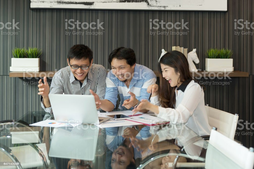 Business people discussing about work in front of laptop in modern meeting room, group of people stock photo