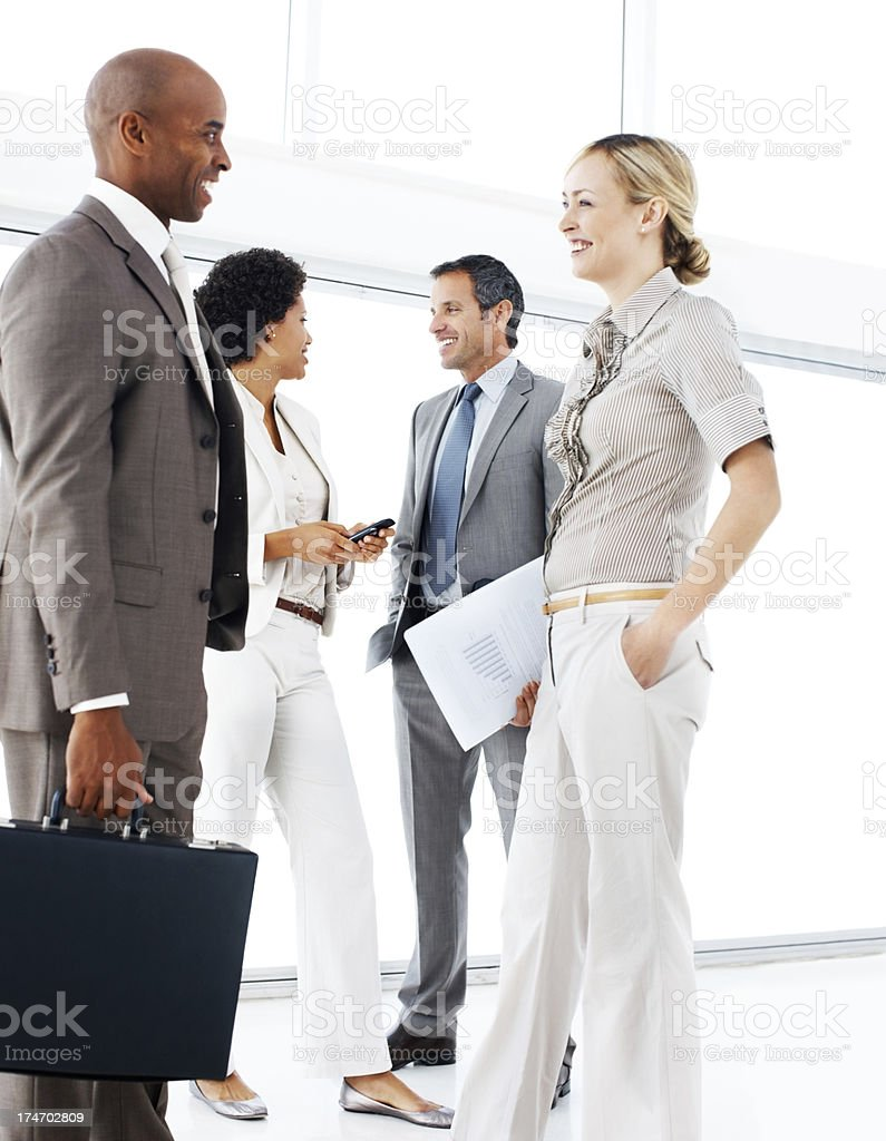 Business people discussing and smiling in an office royalty-free stock photo