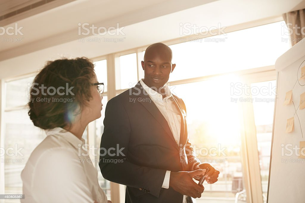 Business people discussing at meeting stock photo