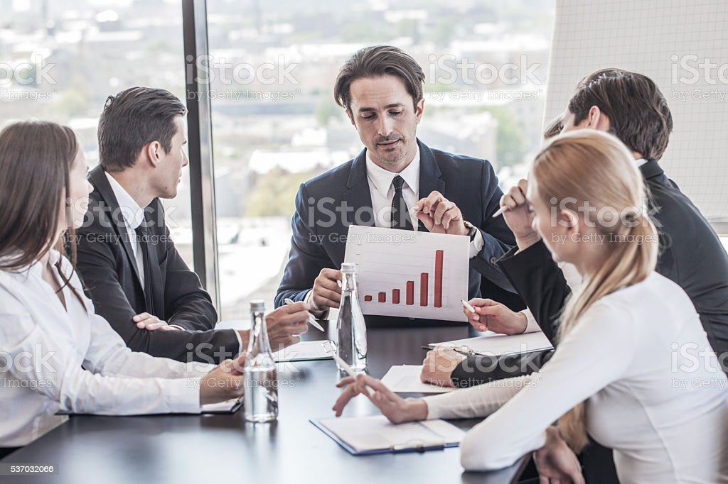 Business people discussing charts stock photo