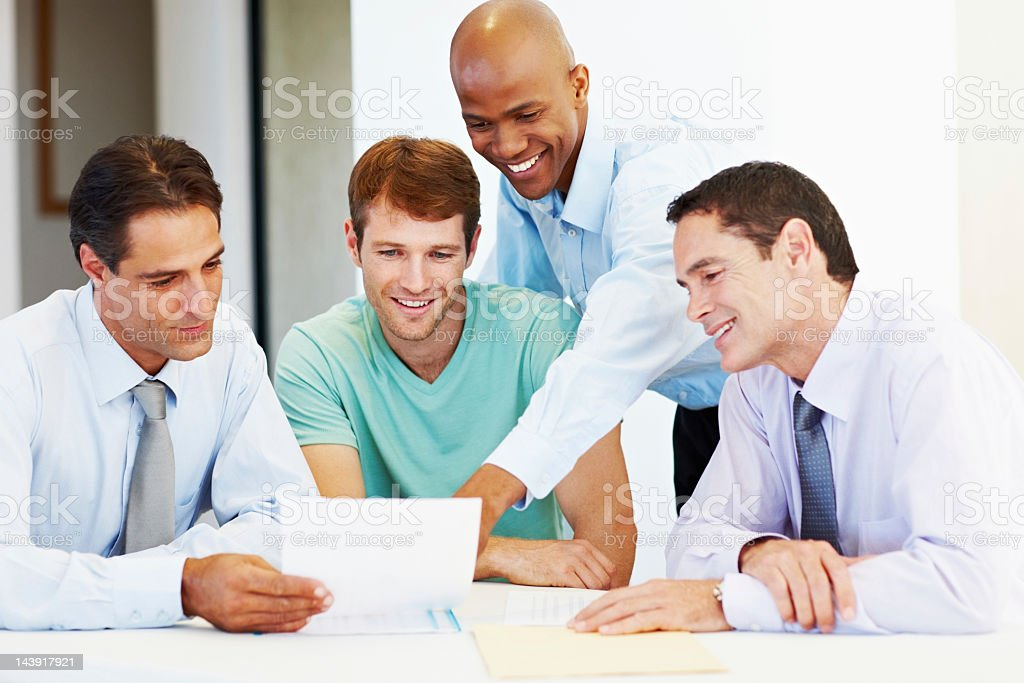 Business people discussing document royalty-free stock photo