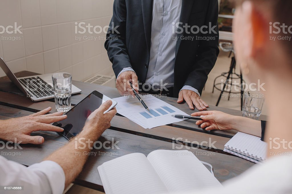 Business people discussing financial growth of the company stock photo