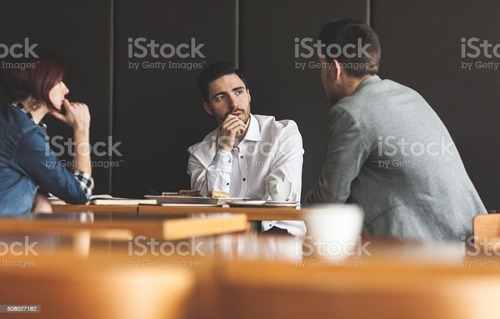 Business people discussing in a cafe stock photo