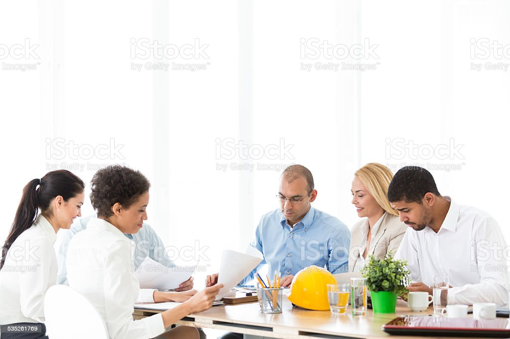 Business people discussing in a meeting stock photo