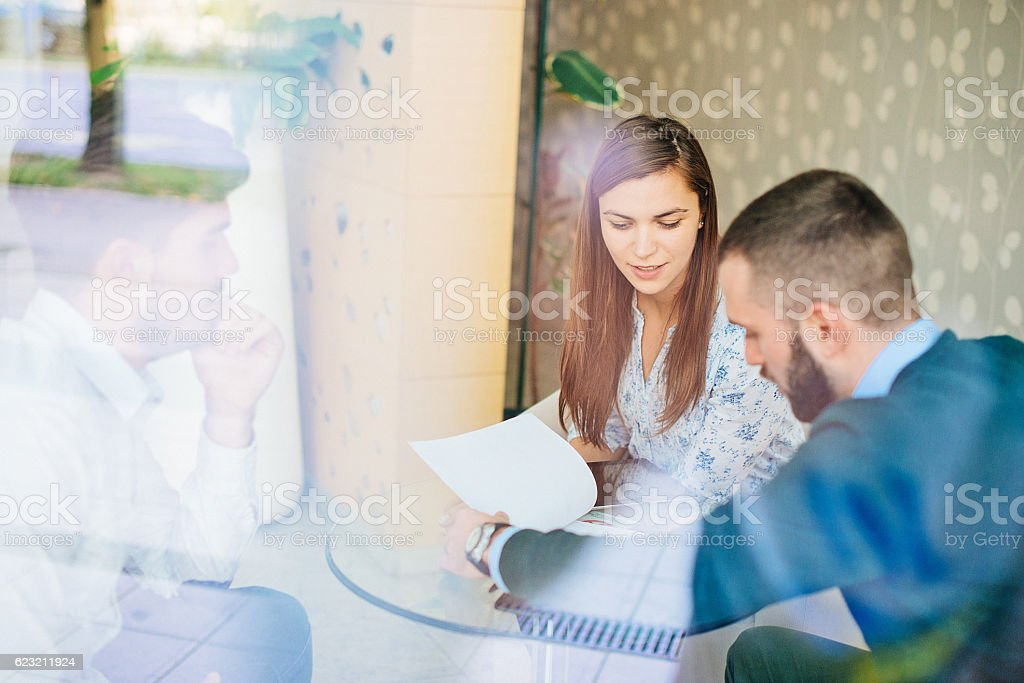 Business people discussing investment results stock photo