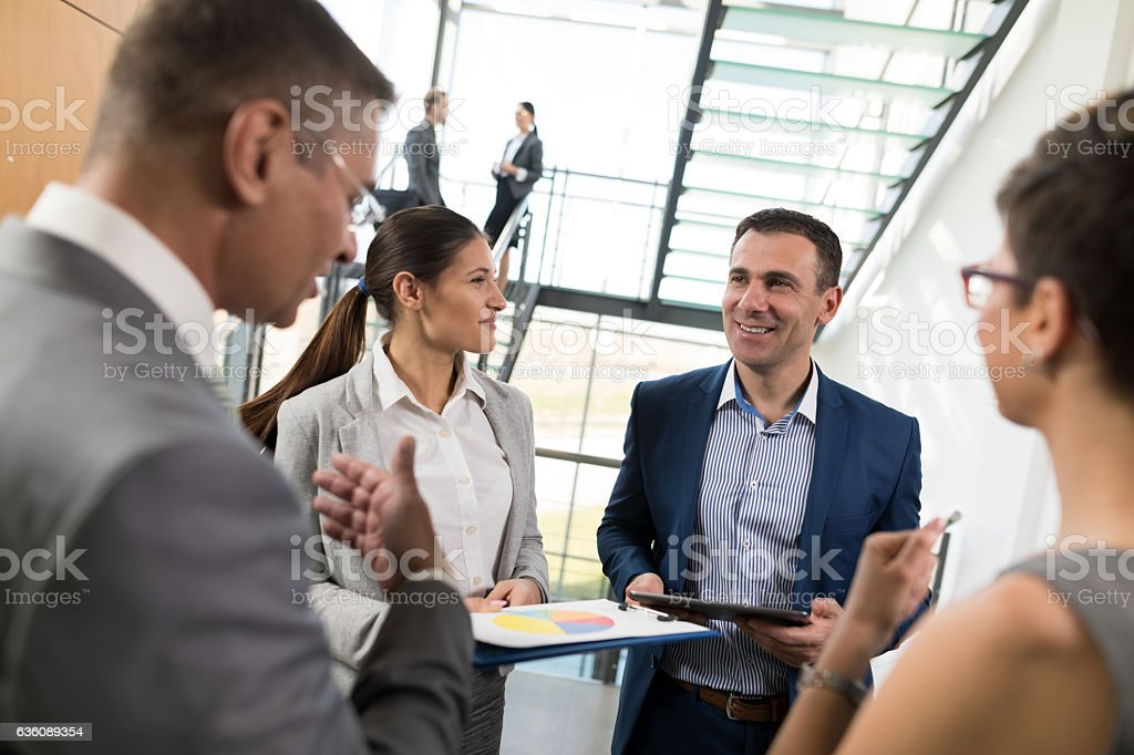 Business people discussing market research statistics stock photo