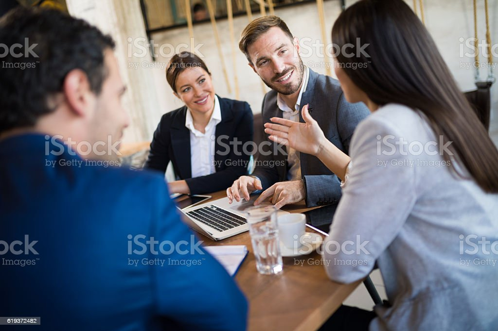 Business people discussing new business strategy during business meeting stock photo