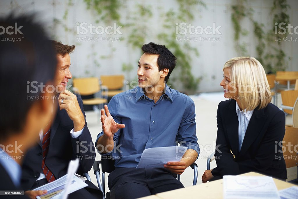 Business people discussing new plans and ideas royalty-free stock photo