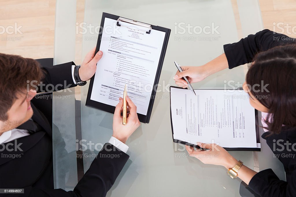 Business People Discussing Over Documents stock photo