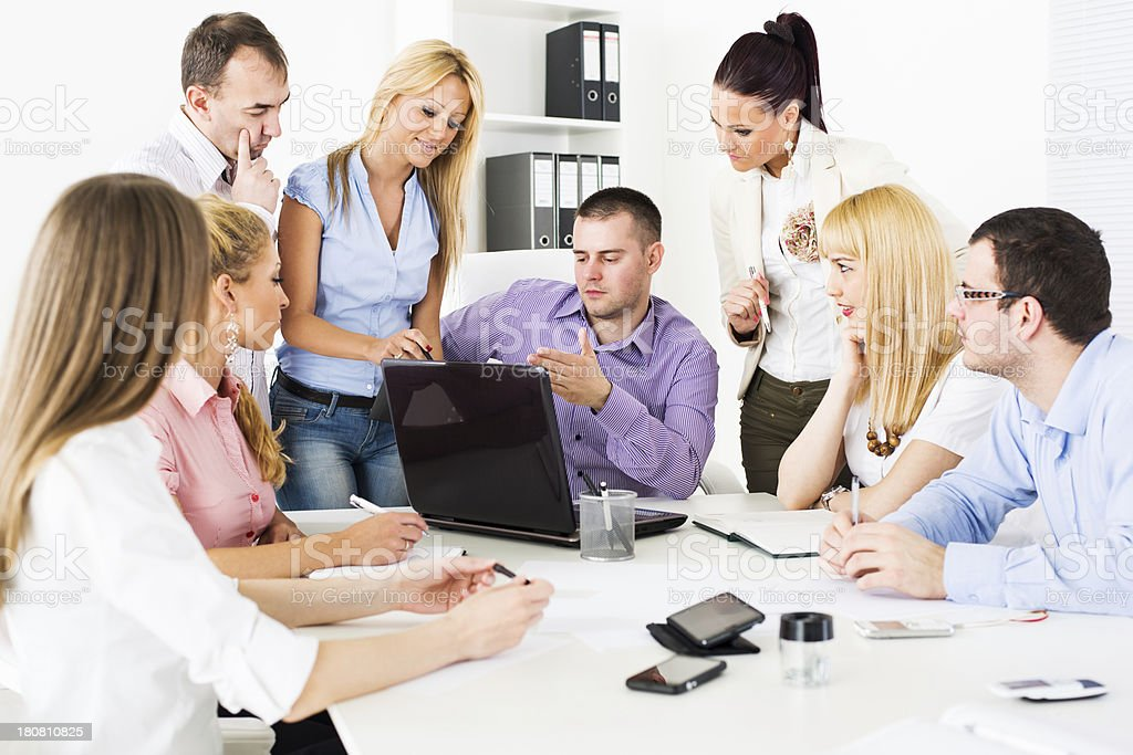 Business people discussing project royalty-free stock photo