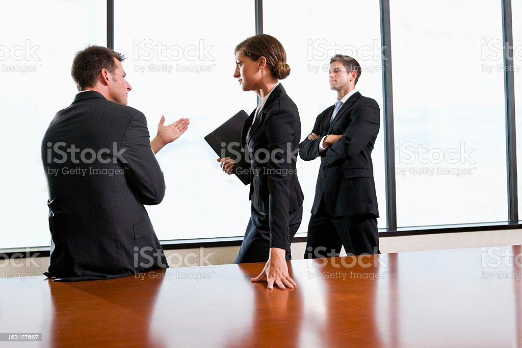 Business people discussing strategy in boardroom stock photo