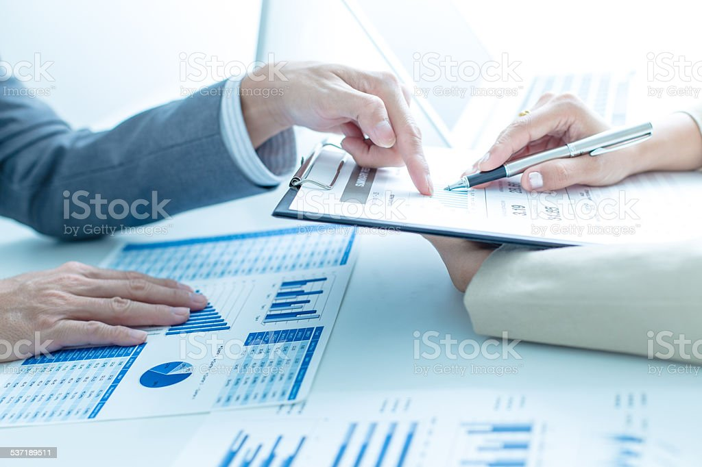 Business people discussing the charts and graphs showing the res stock photo