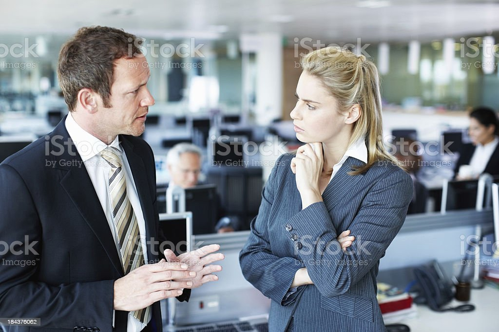 Business people discussing with each other stock photo