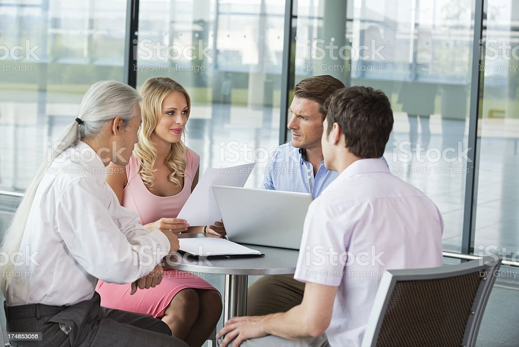 Business People Discussing Work At Table royalty-free stock photo