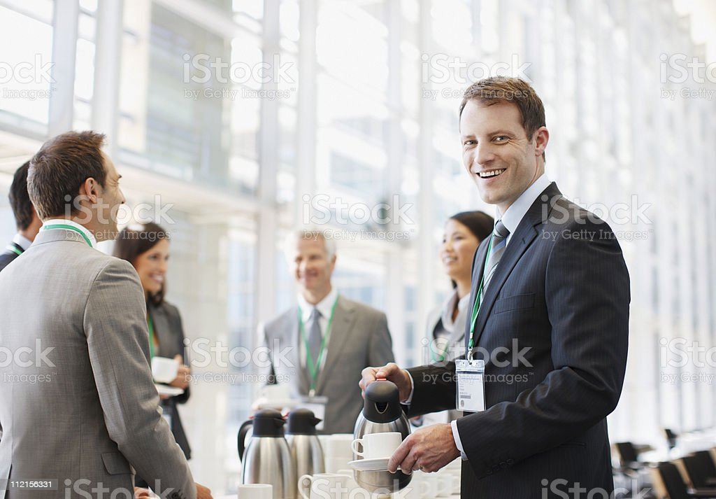 Business people drinking coffee in office stock photo