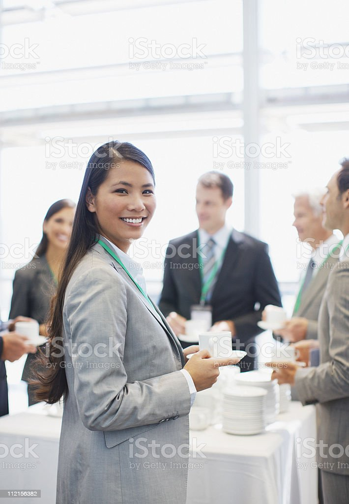 Business people drinking coffee in office royalty-free stock photo
