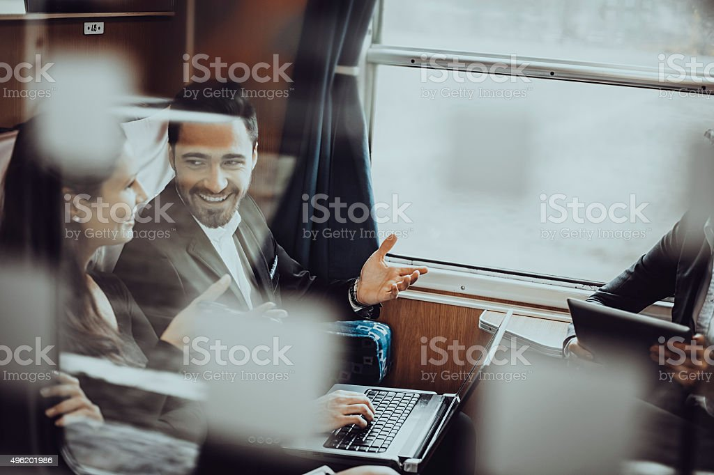 Business people during a train journey, working stock photo