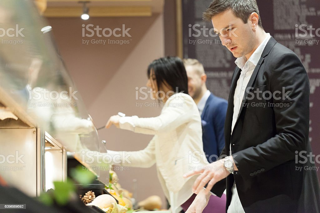 Business people eating in cafeteria stock photo