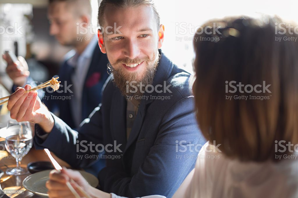 Business people eating sushi stock photo