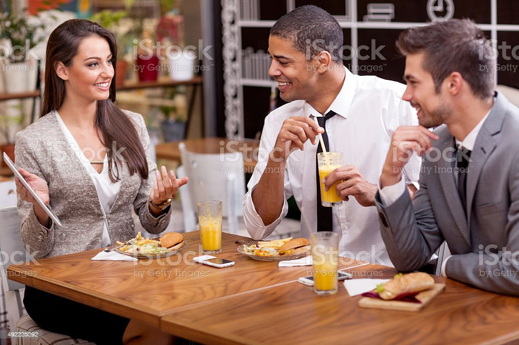 Business people enjoy in lunch at restaurant stock photo