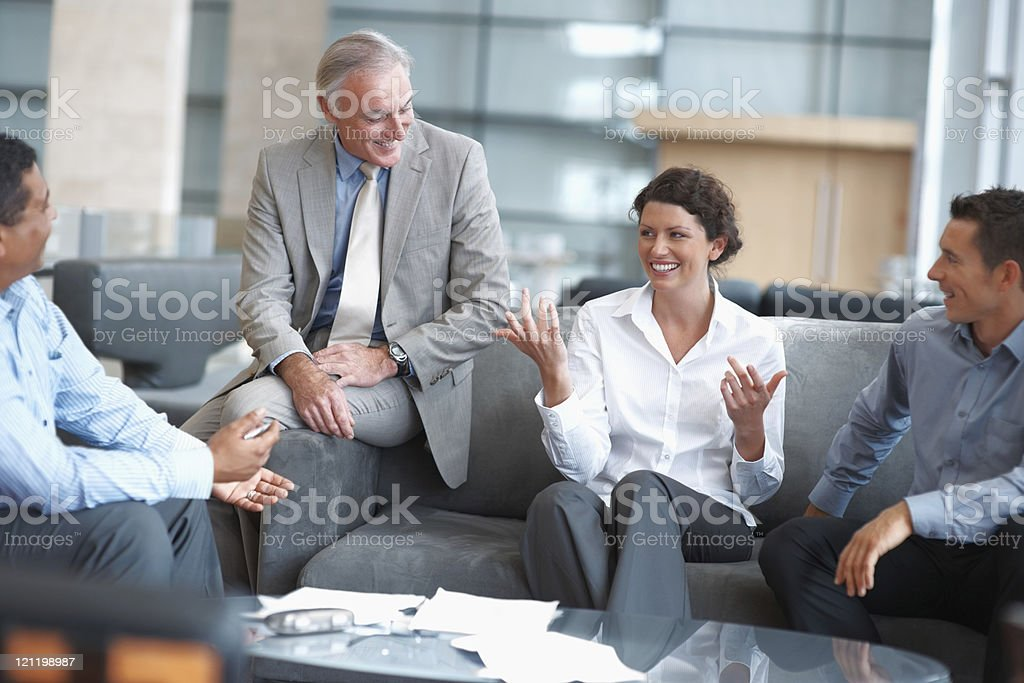 Business people enjoying a casual talk at the office lounge royalty-free stock photo