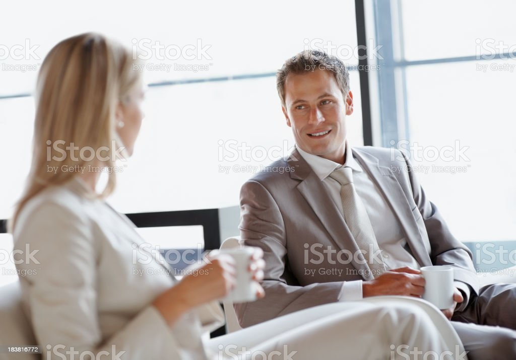 Business people enjoying coffee together royalty-free stock photo