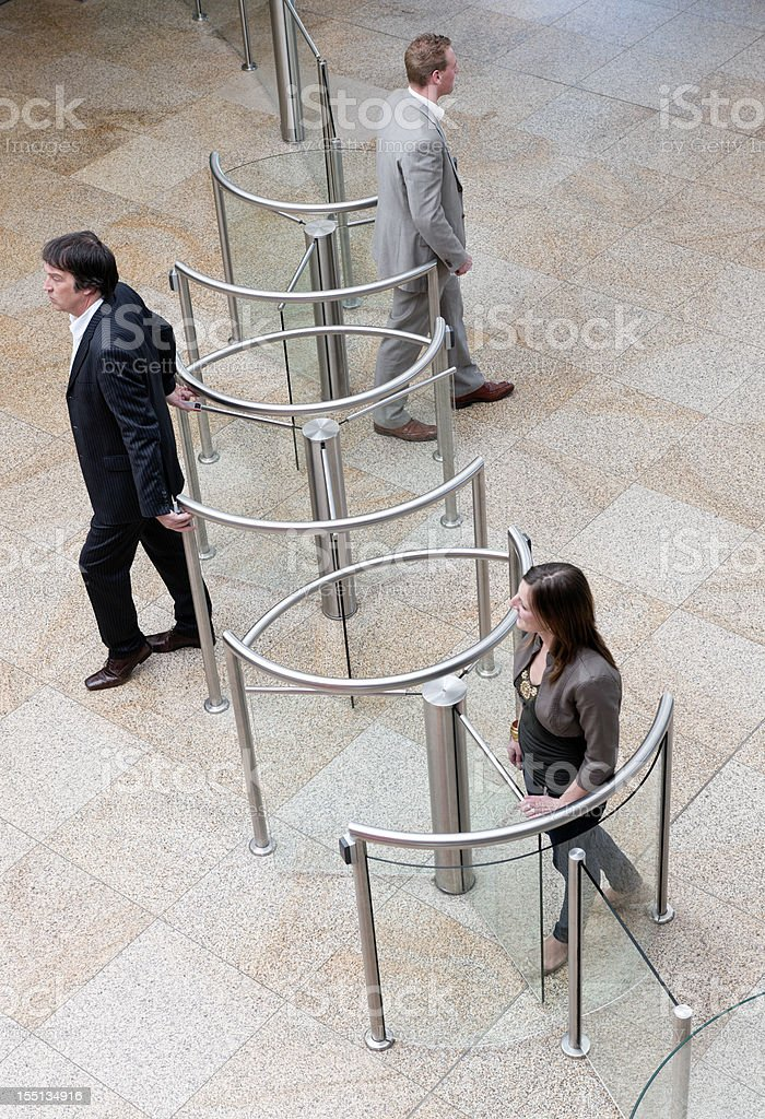 business people entering and leaving lobby royalty-free stock photo