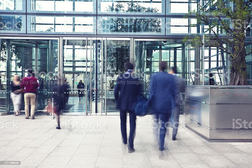 Business People Entering and Leaving Office Building, Motion Blur royalty-free stock photo