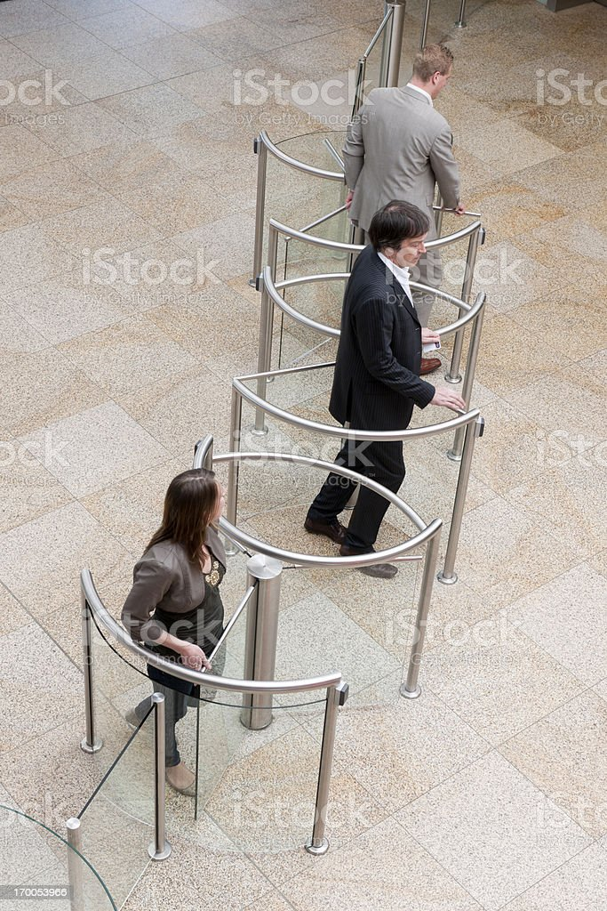 business people entering lobby stock photo