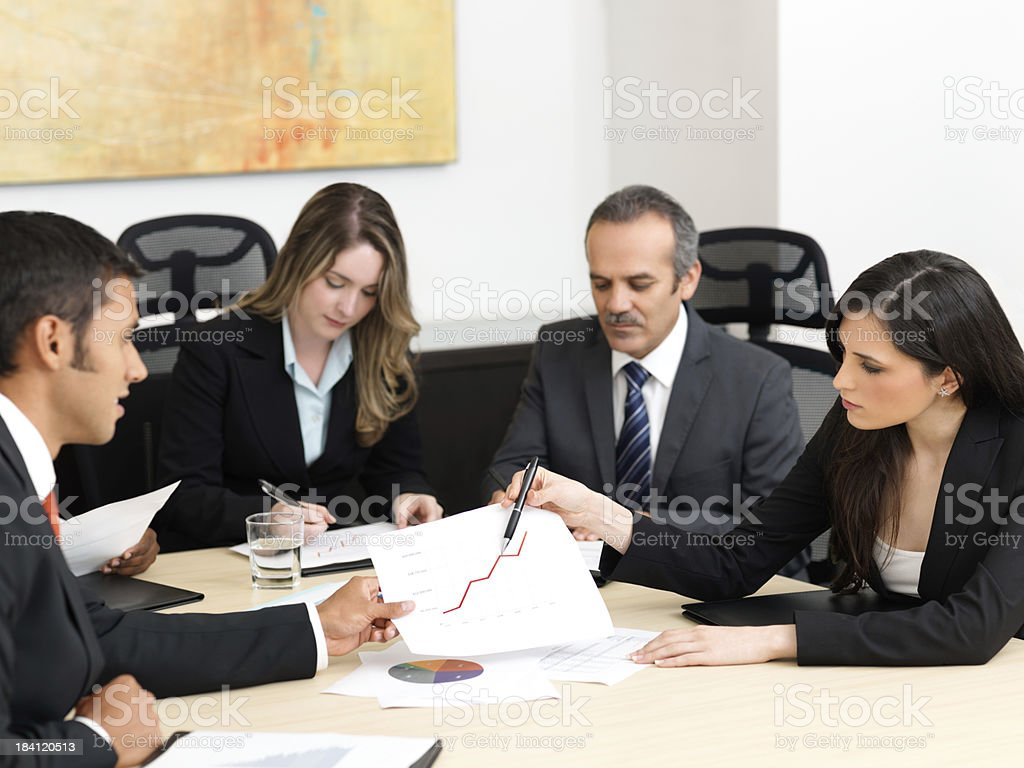 Business people examining graphics royalty-free stock photo