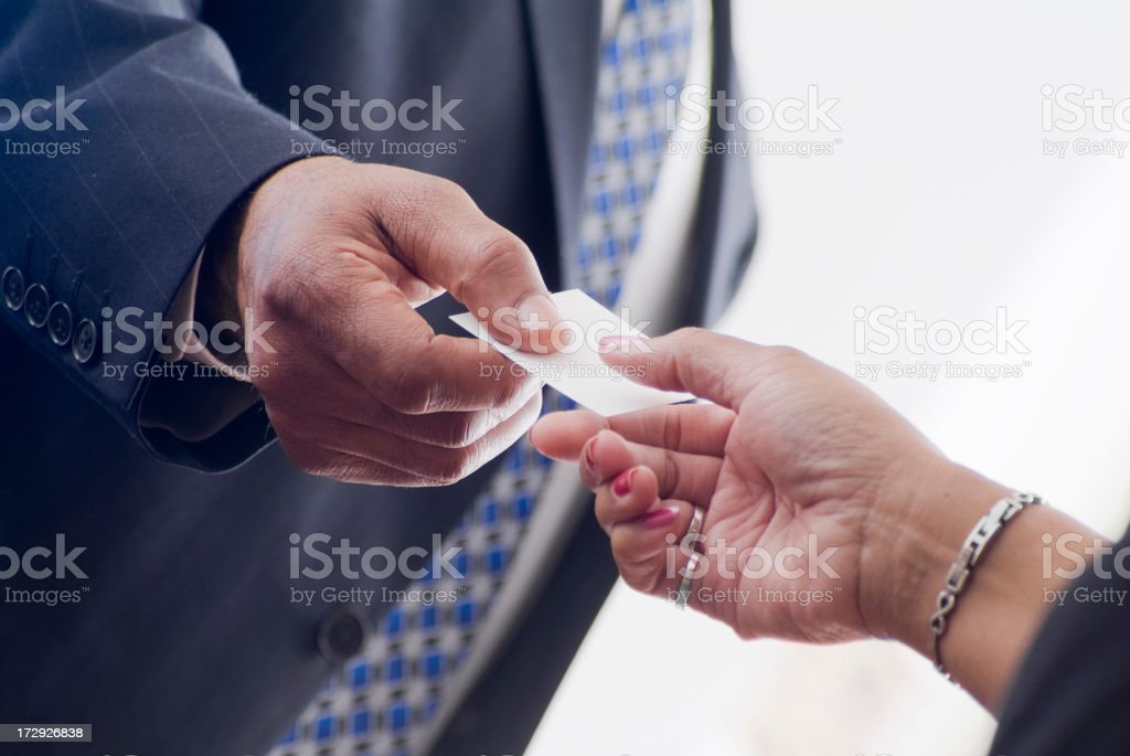 Business people exchange business cards royalty-free stock photo
