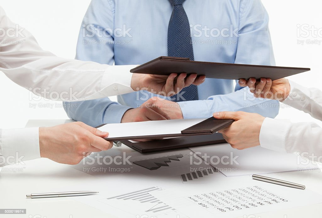 Business people exchanging  documents stock photo