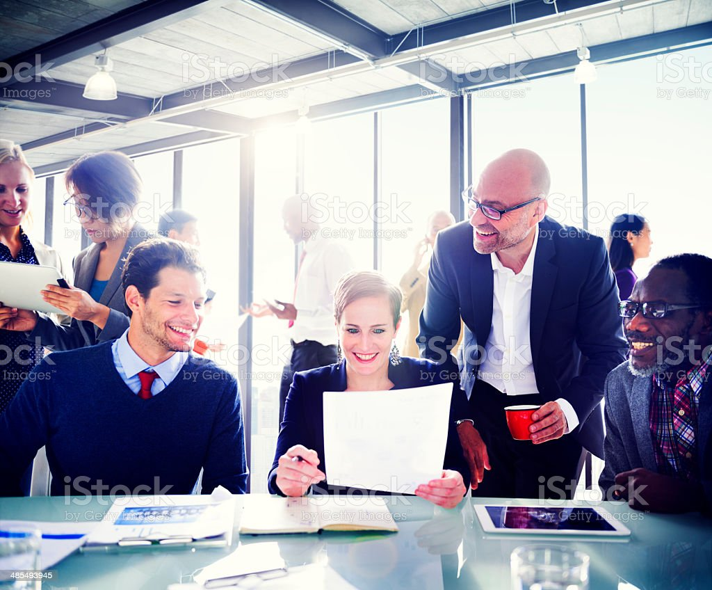 Business People Expressing Positivity Around The Conference Tabl stock photo