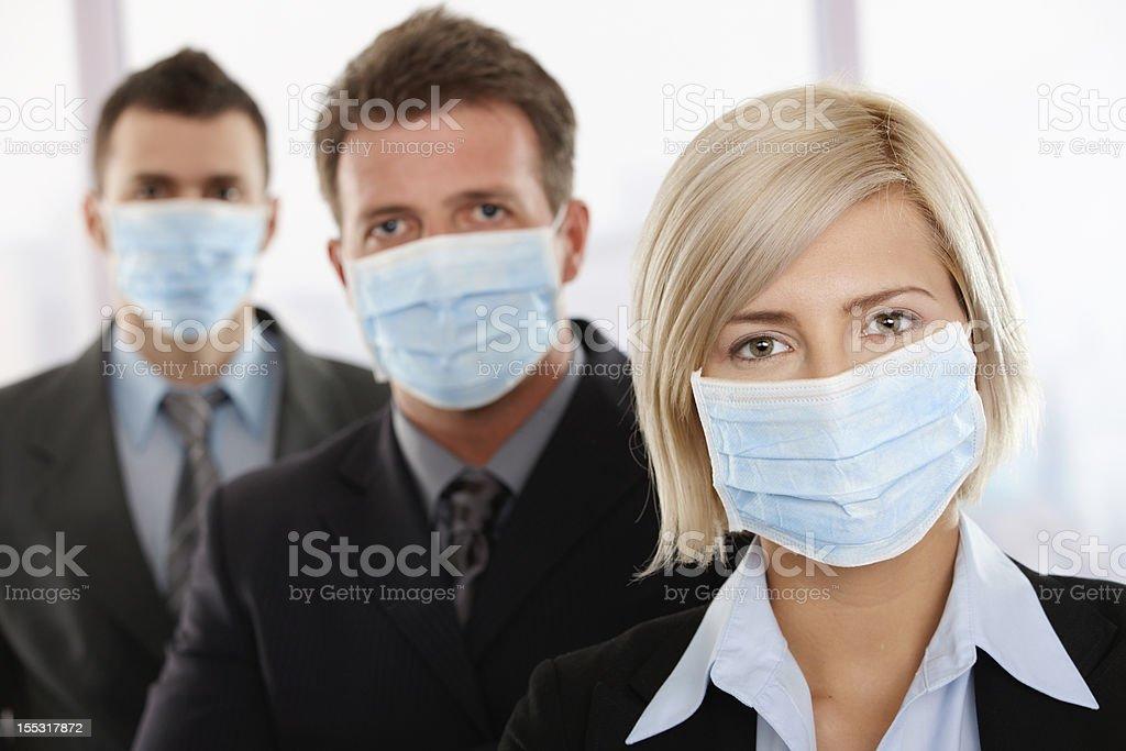 Business people fearing h1n1 virus stock photo