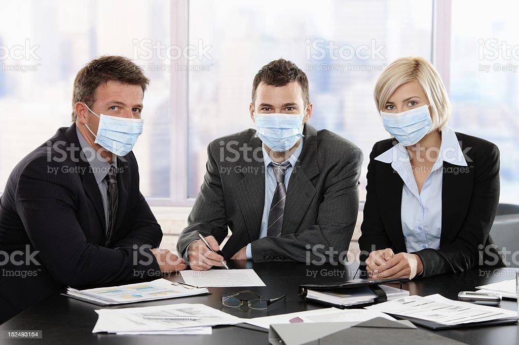 Business people fearing swineflu virus royalty-free stock photo