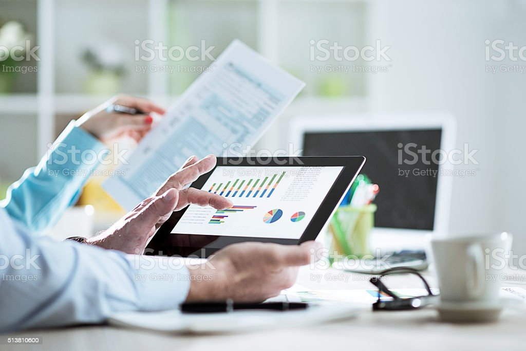 Business people filling out tax form 1040 in office stock photo