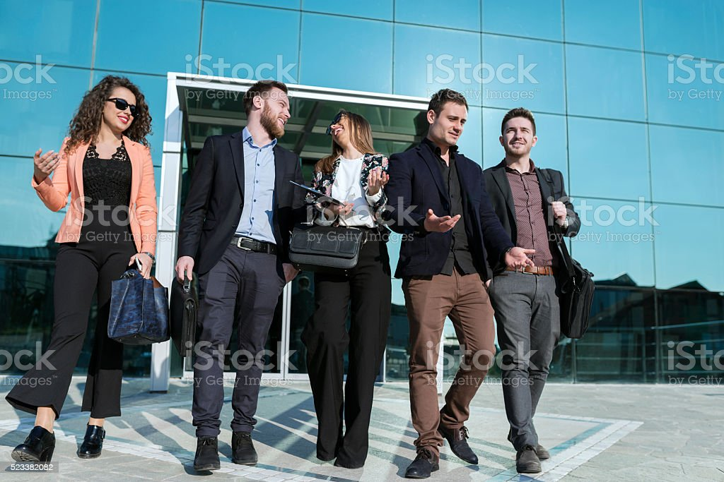 Business People Finished With Work Walking out of the Office stock photo
