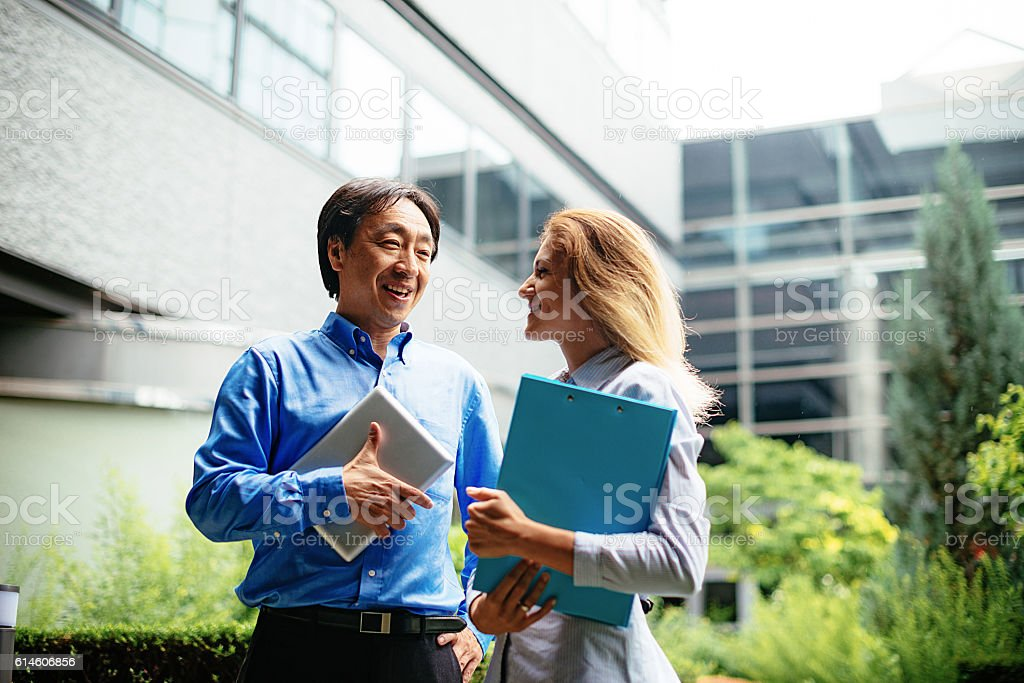 Business people from Europe and Japan stock photo