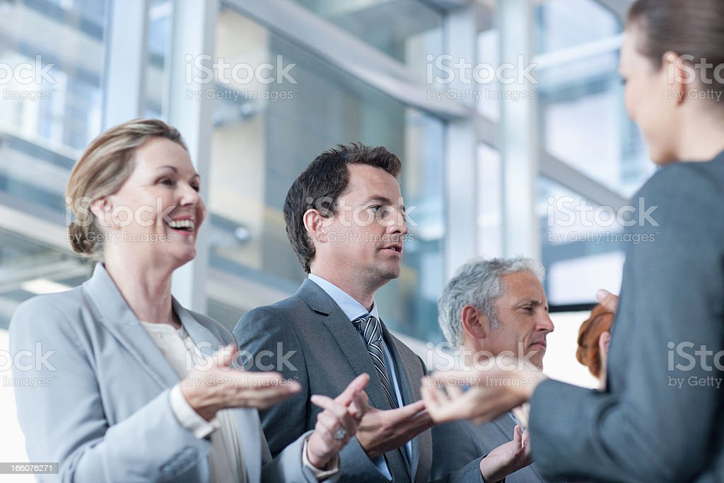 Business people gesturing face to face royalty-free stock photo