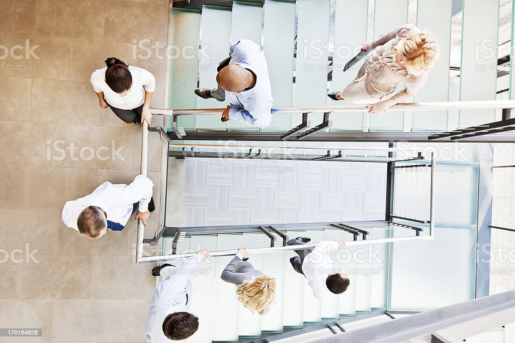 Business people going down the stairs. stock photo