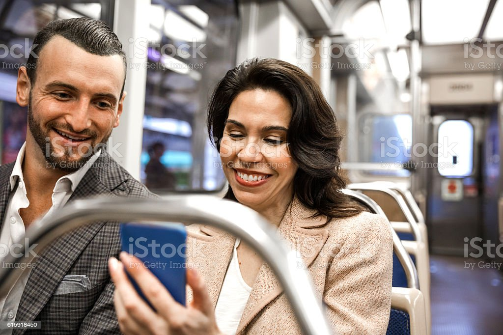 Business people going to work in the subway train stock photo