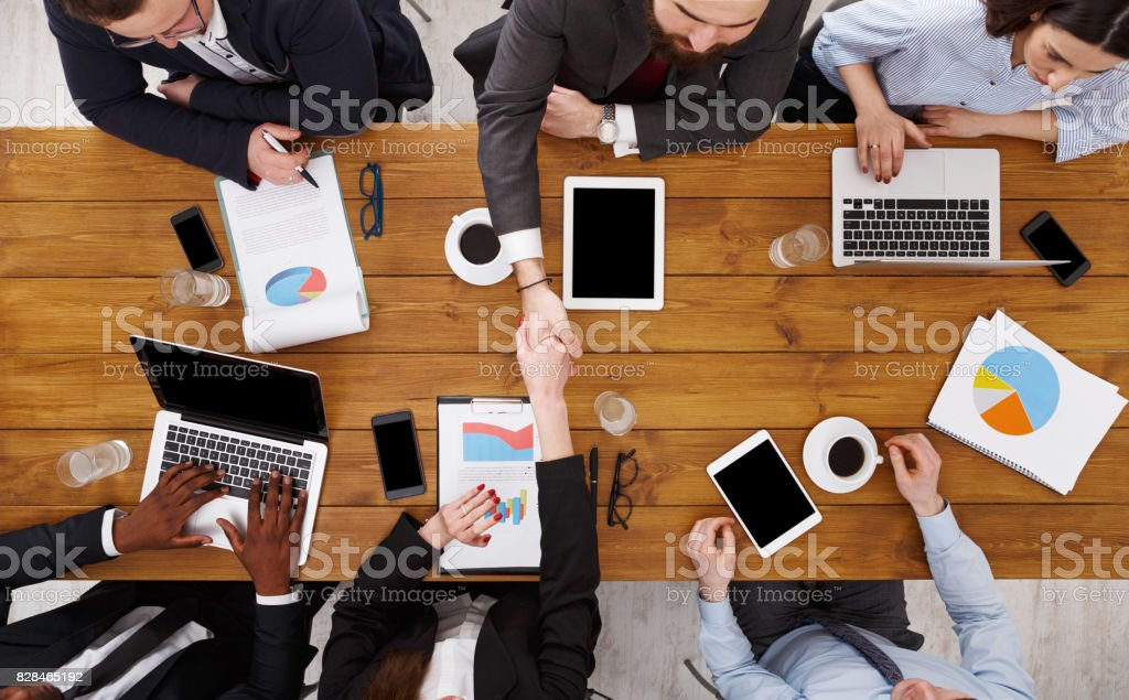 Business handshake. Agreement at meeting. Busy people work in office,...