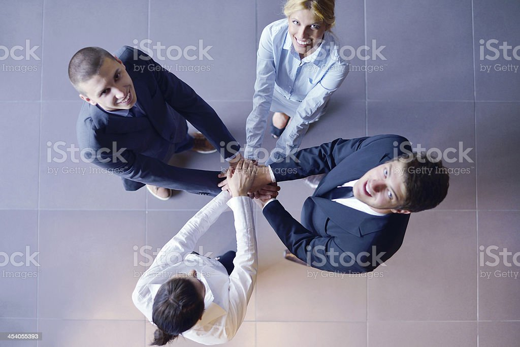 business people group joining hands royalty-free stock photo