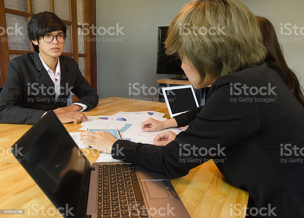 Business people group view graph in tablet for analysis business. stock photo